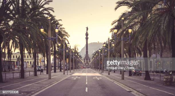 passeig de colom (columbus street) towards the monument with the representation of christopher columbus. - barcelona spain stock pictures, royalty-free photos & images