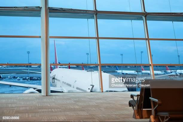 Passenger aircraft at empty airport terminal