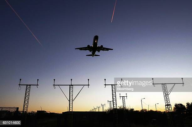 A passenger aircraft flies over landing lights as it prepares to land at London City Airport in London UK on Thursday Jan 5 2017 Alitalia SpA...