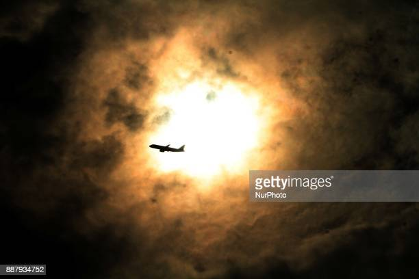 A passenger aircraft is seen shilhoutted in the sky rain clouds hover before the down pour after a depression formatted in the Bay of Bengal Sea...