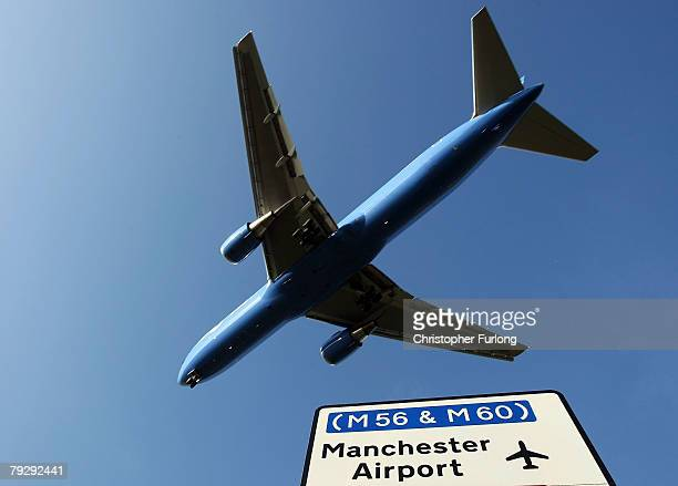 Passenger aircraft landing at Manchester International Airport approaches the runway on 28 January Manchester, England. Baggage handlers at the...