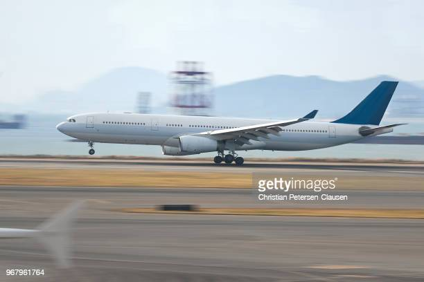 passenger aircraft landing on airport runway - landing gear stock photos and pictures