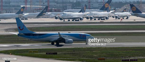 A passenger aircraft of tour operator TUI lands at the airport of Frankfurt am Main western Germany on March 16 where air traffic slowed down due to...