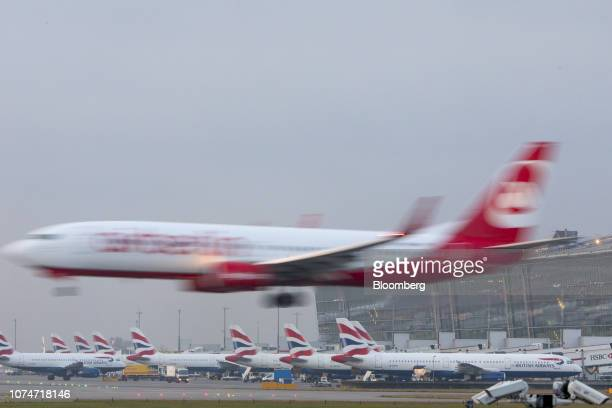 A passenger aircraft operated by Air Berlin Plc lands near passenger aircraft operated by British Airways a unit of International Consolidated...