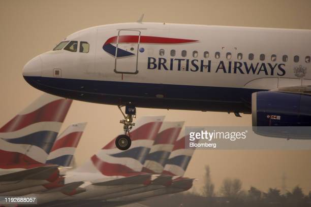 A passenger aircraft operated by British Airways a unit of International Consolidated Airlines Group SA lands at London Heathrow Airport in London UK...