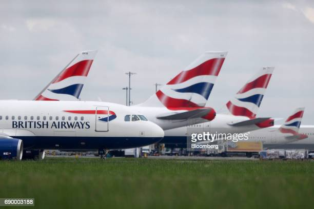 A passenger aircraft operated by British Airways a unit of International Consolidated Airlines Group SA passes other British Airways passenger...