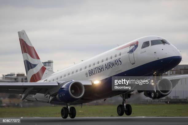 A passenger aircraft operated by British Airways a unit of International Consolidated Airlines Group SA lands at London City Airport in London UK on...