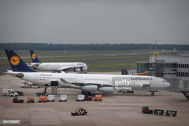 Passenger aircraft operated by Deutsche Lufthansa AG stand on the tarmac at Dusseldorf airport operated by Flughafen Dusseldorf GmbH in Dusseldorf...