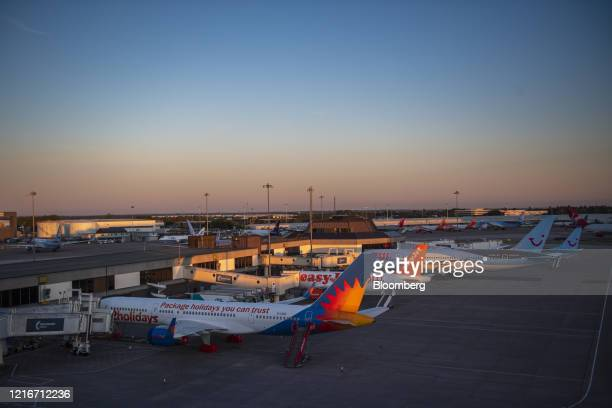 Passenger aircraft, operated by Jet2holidays Ltd., Easyjet Plc and Tui AG, stand grounded at Manchester Airport, operated by Manchester Airport Plc,...