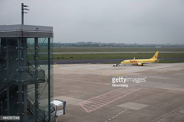 A passenger aircraft operated by lowcost airline TUI Fly is towed on the tarmac at Dusseldorf airport operated by Flughafen Dusseldorf GmbH in...
