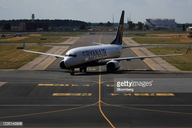 Passenger aircraft operated by Ryanair Holdings Plc taxis after arriving from London, U.K. As European Union travel restrictions are lifted at Berlin...
