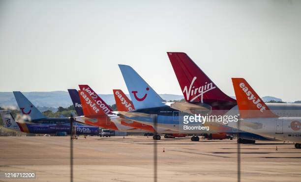 Passenger aircraft, operated by Tui AG, Easyjet Plc, Virgin Atlantic Airways Ltd., Jet2 Com Ltd., sit grounded on the tarmac at Manchester Airport,...
