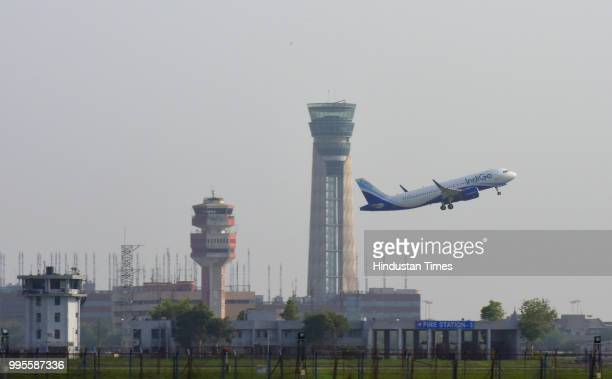 A passenger aircraft seen flying over new ATC Tower at Terminal 3 of Indira Gandhi International Airport on July 8 2018 in New Delhi India