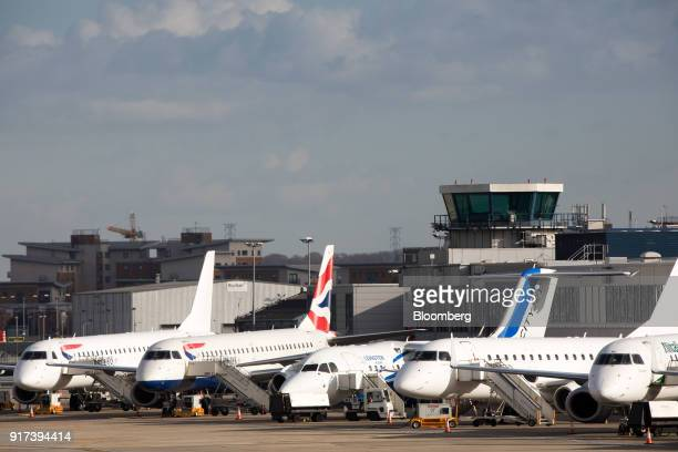 Passenger aircraft sit grounded on the tarmac at London City Airport, following the discovery of an unexploded bomb, in London, U.K., on Monday, Feb....