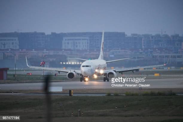 passenger aircraft with landing lights taxiing - taxiing stock pictures, royalty-free photos & images