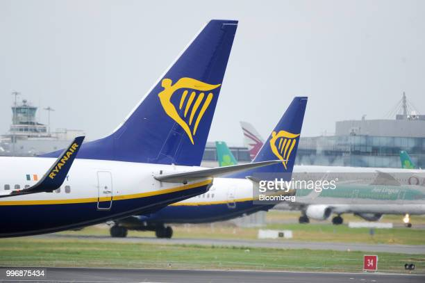 Passenger aircrafts operated by Ryanair Holdings Plc taxi on the tarmac at Dublin Airport in Dublin Ireland on Thursday July 12 2018 Ryanair grounded...