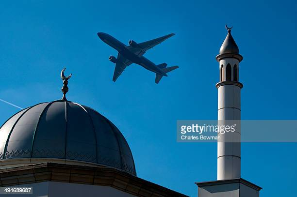 passenger airliner overflies hounslow mosque - floating mosque stock pictures, royalty-free photos & images