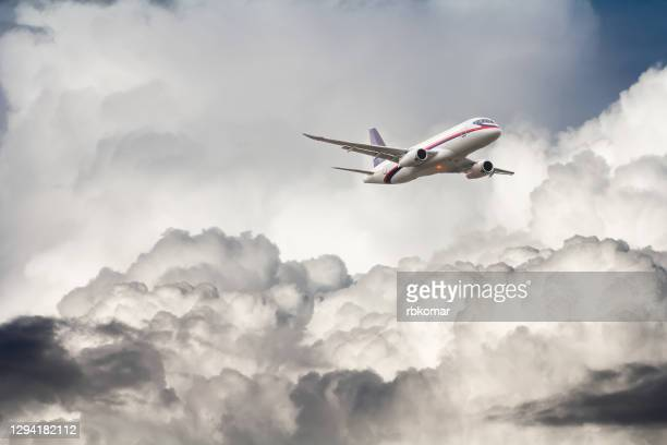 passenger airplane flying in stormy clouds and air turbulence - failure stock pictures, royalty-free photos & images