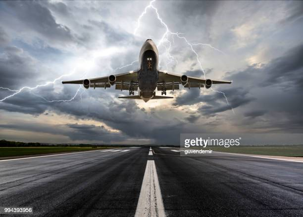 passenger airplane landing on extreme weather - lightning stock pictures, royalty-free photos & images