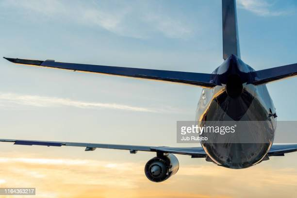 passenger airplane taking off at sunset - chonburi province stock pictures, royalty-free photos & images