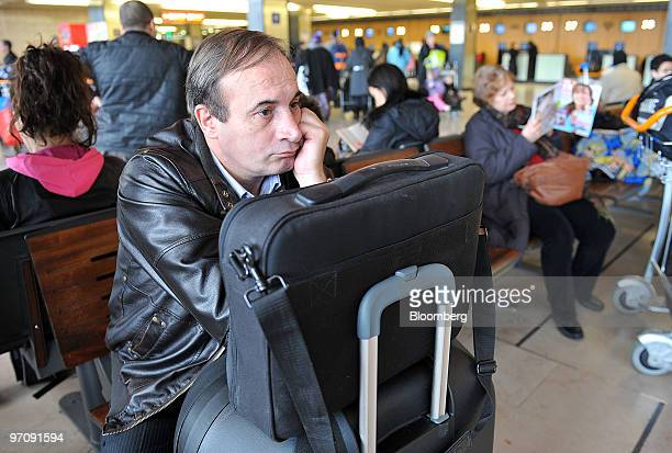 Passenger Alain Avronsart waits for his plane during an airtraffic controller's strike at Orly airport near Paris France on Friday Feb 26 2010 About...