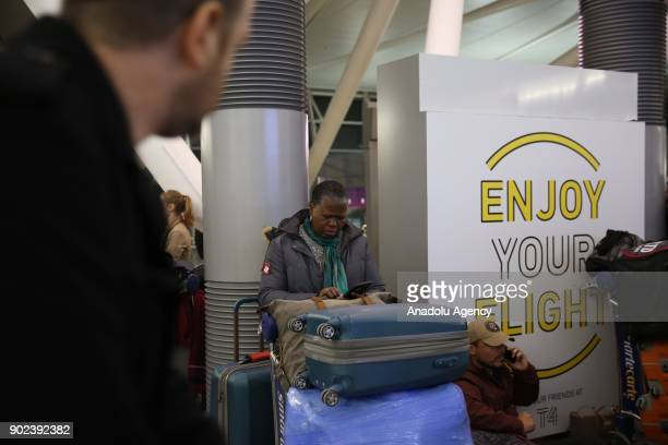 A passenger and her luggage are seen during the weatherrelated cancellation at the John F Kennedy Airport in New York United States on January 08...