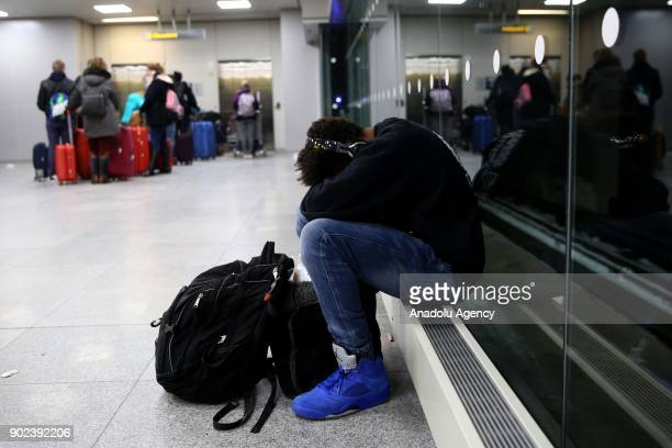 A passenger and his luggage are seen during the weatherrelated cancellation at the John F Kennedy Airport in New York United States on January 08...