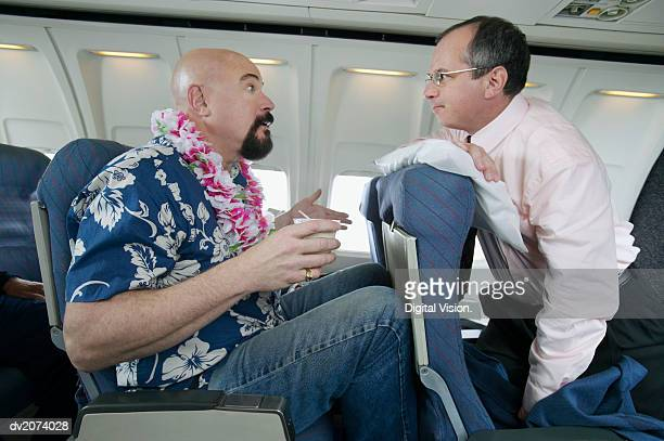 Passenger Angry About Seating Space on a Passenger Aeroplane
