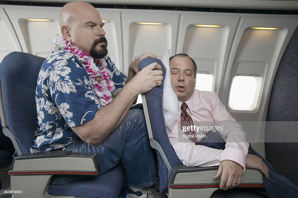 Passenger Angry About the Lack of Seating Space on a Aeroplane : Stock Photo