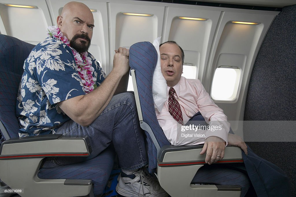 Passenger Angry About the Lack of Seating Space on an Aeroplane : Stock Photo