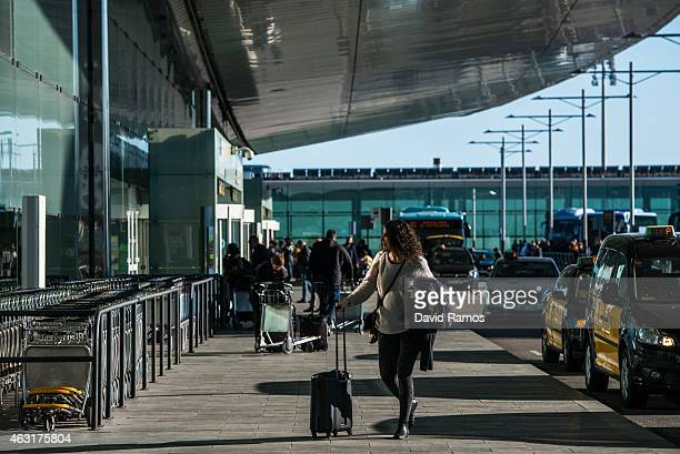 A passenger arrives at Aena operated Barcelona El Prat International Airport on February 10 2015 in Barcelona Spain Shares in statecontrolled Spanish...