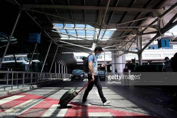 Passenger arrives at Lisbon airport in Portugal on May 19, 2021. British vacationers began arriving in large numbers in Portugal on Monday, after...
