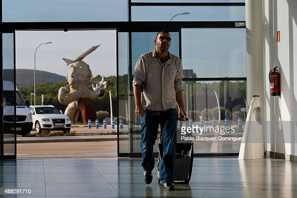 A passenger arrives at the airport as the Ripolles' statue 'La Paz' is seen in the background before the first commercial flight takes off from...