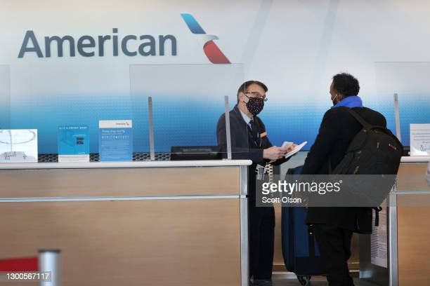 Passenger arrives for an American Airlines flight at O'Hare International Airport on February 05, 2021 in Chicago, Illinois. American Airlines and...