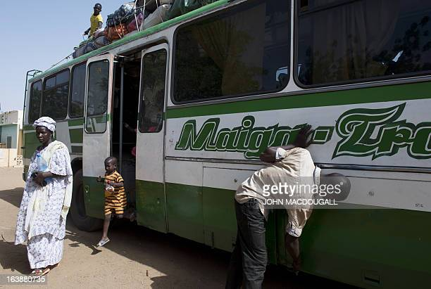 Passenger arriving from the capital Bamako alights from the bus in the northern Malian city of Gao on March 11, 2013. The city's inhabitants who had...