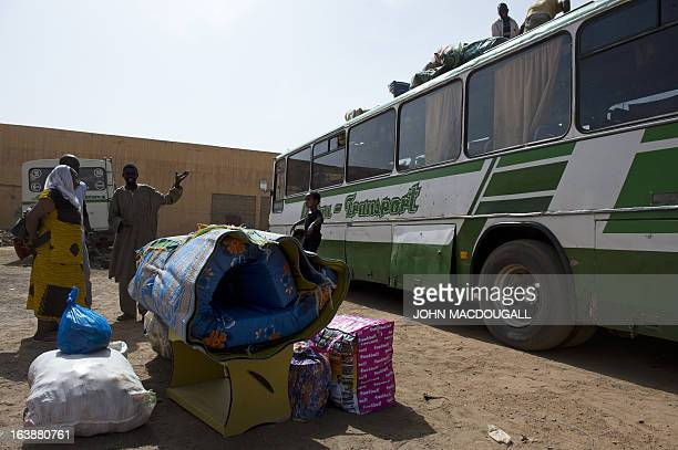 Passenger arriving from the capital Bamako collects her belongings in the northern Malian city of Gao on March 11, 2013. The city's inhabitants who...