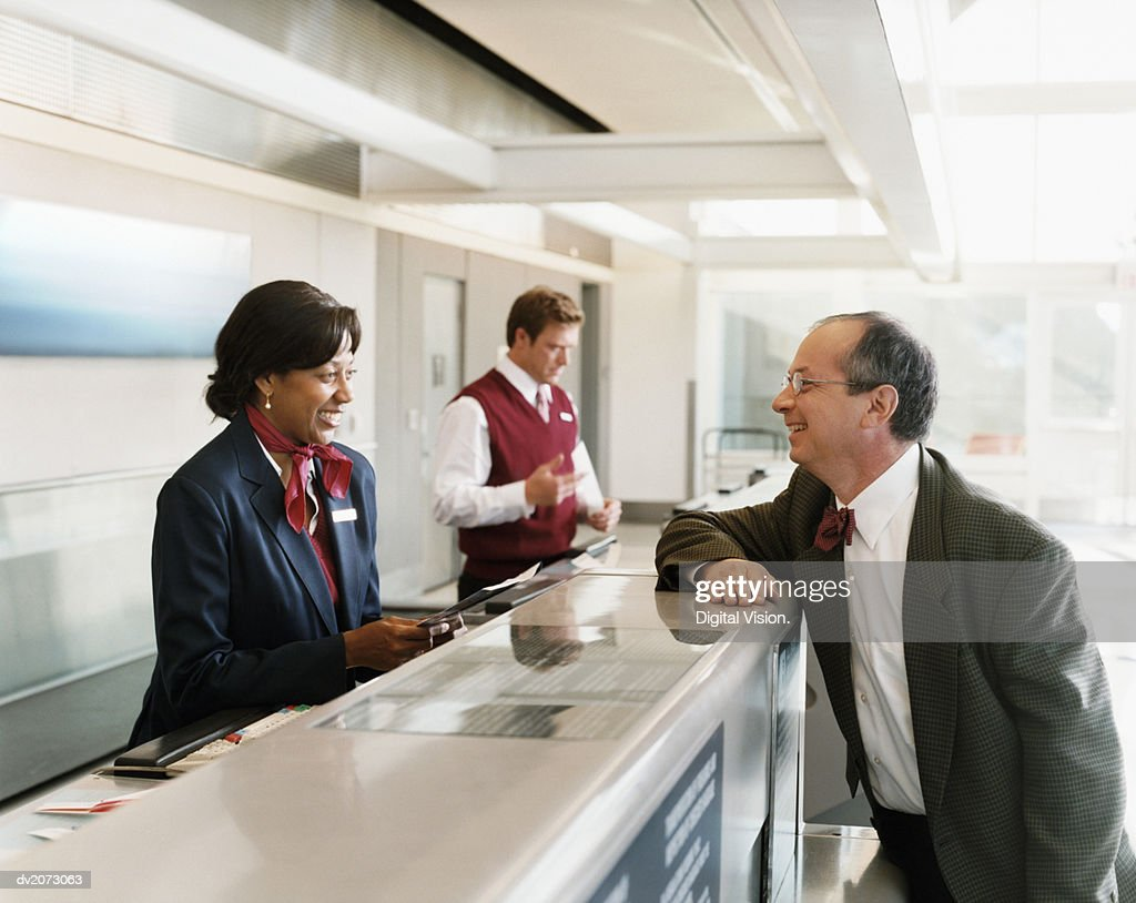 Passenger at Airport Check-in Desk : Stock Photo