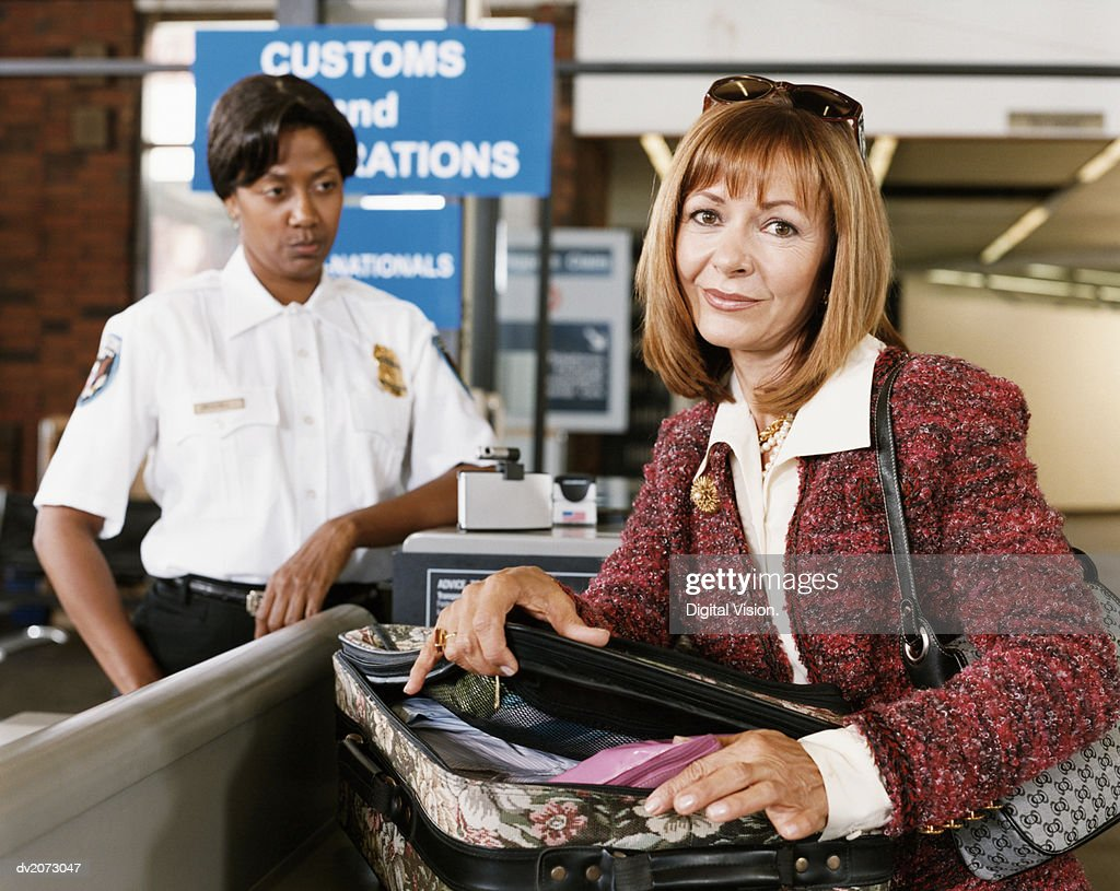 Passenger at Airport Security and Security Officer : Stock Photo