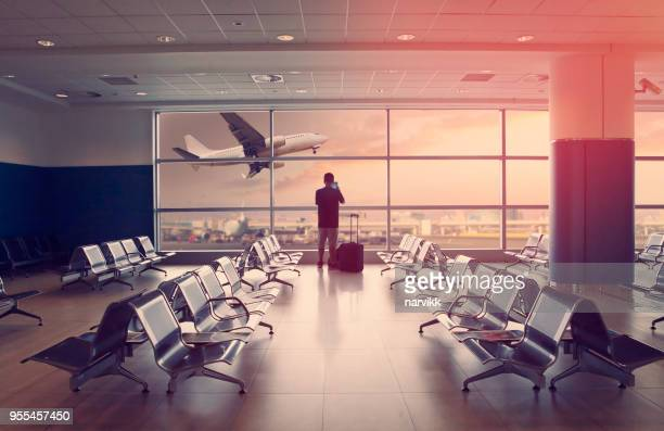 passenger at the airport and landing airplane - commercial airplane stock pictures, royalty-free photos & images