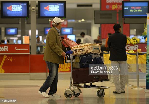 A passenger at the arrival hall at Terminal 3 of Indira Gandhi International airport in New Delhi on November 5 2014 AFP PHOTO/ Prakash SINGH