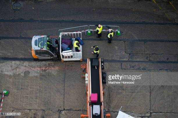 Passenger bags are loaded onto a cruise ship by baggage handlers at the Port of Southampton on February 10 2019 in Southampton England The Port of...