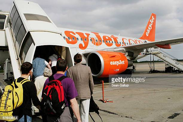 Passenger board a plane of discount airline Easyjet at Schoenefeld Airport May 17 2006 in Berlin Germany The company's 1500 cabin crew are reportedly...