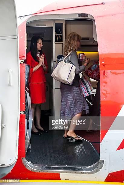 Passenger boarding Air Asia jet in Hanoi, Vietnam