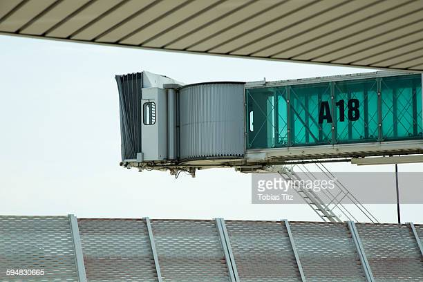 Passenger boarding bridge against clear sky