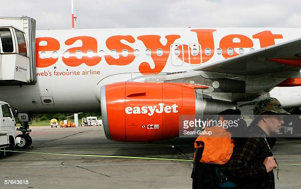 A passenger boards a plane of discount airline Easyjet at Schoenefeld Airport May 17 2006 in Berlin Germany The company's 1500 cabin crew are...