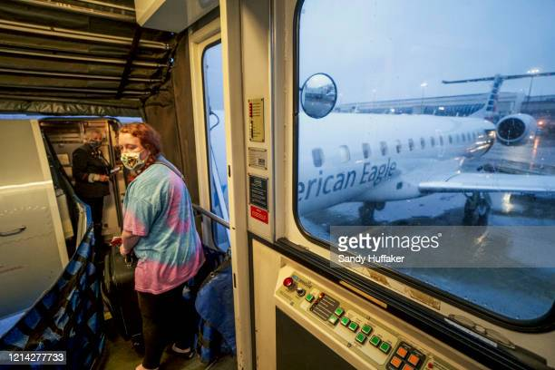 A passenger boards an American Airlines flight to Roanoke Virginia at Charlotte International Airport on May 20 2020 in Charlotte North Carolina Air...