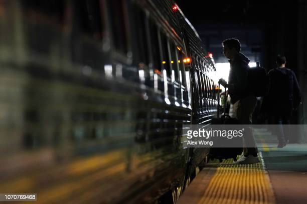 Passenger boards an Amtrak train at Union Station on the day before the Thanksgiving holiday November 21, 2018 in Washington, DC. Holiday travel...