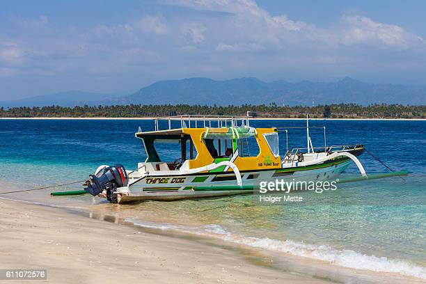 passenger boat in the gili islands in lombok, bali - gili trawangan stock photos and pictures
