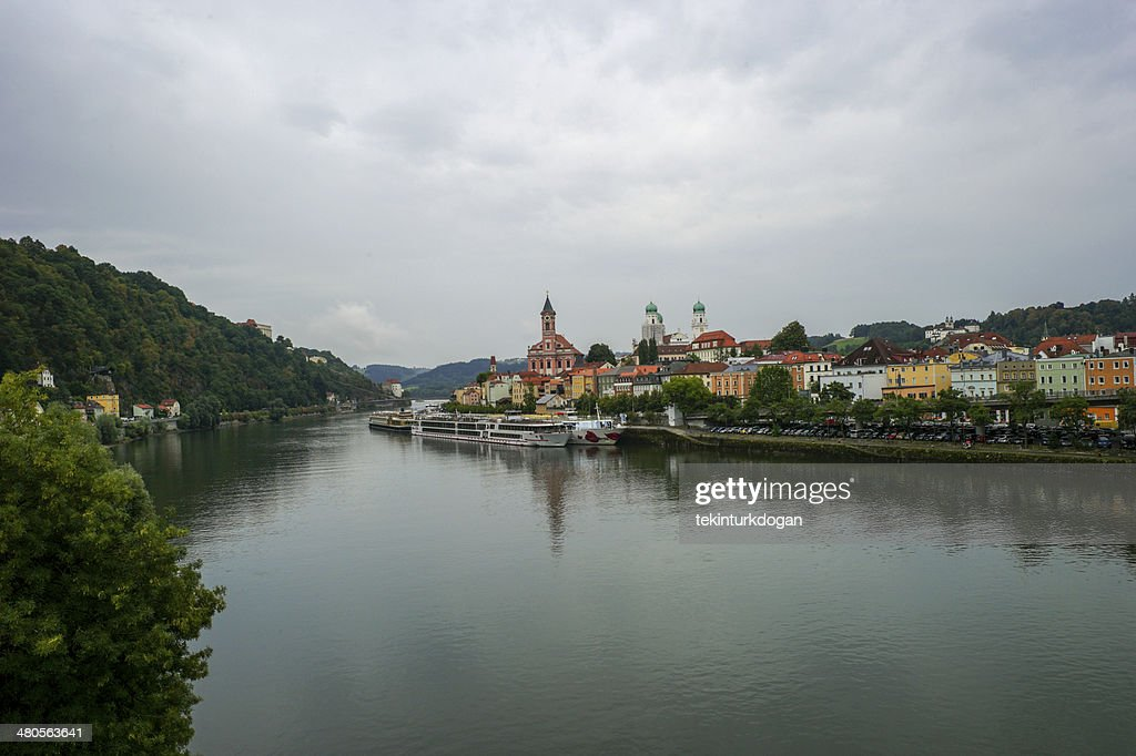 passenger boats are at danube river coast of passau germany : Stock Photo