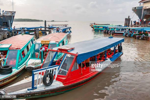 passenger boats with commuters docked in georgetown guyana - guyana stock pictures, royalty-free photos & images